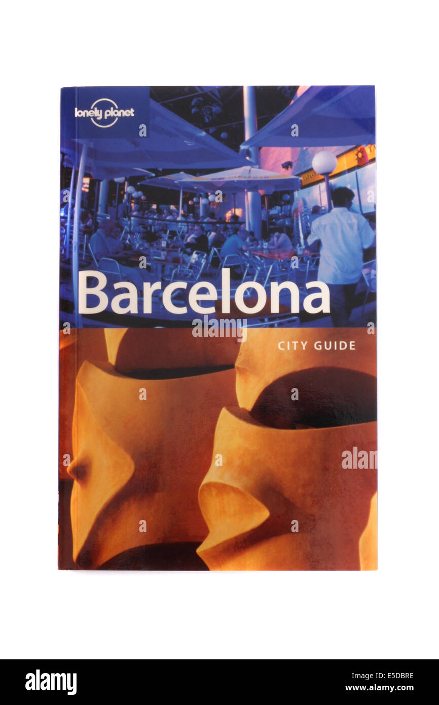 Lonely planet travel book to Barcelona on a white back ground. - Stock Image