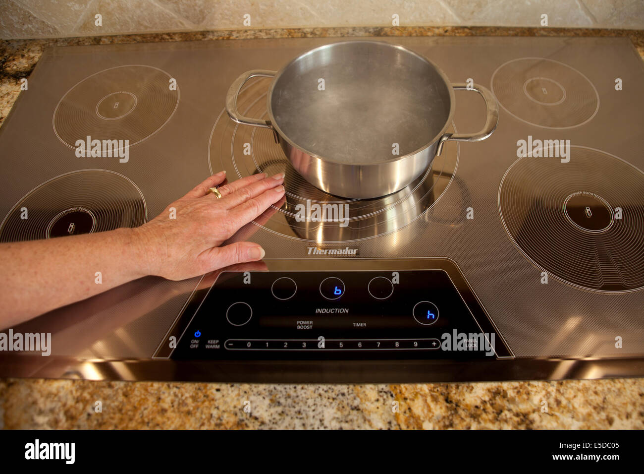 Magnetic energy of Energy saving Thermador Induction cooktop with boiling water Series of 4 images.  MR  © - Stock Image
