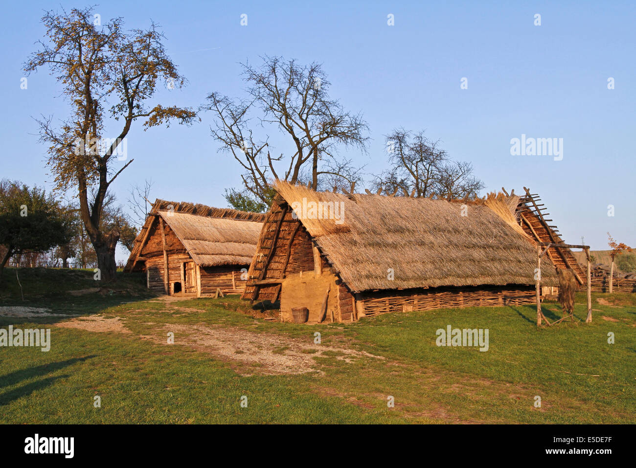 Replica of prehistorical stables in Modra museum /Czech Republic - wooden house with thatch roof - Stock Image