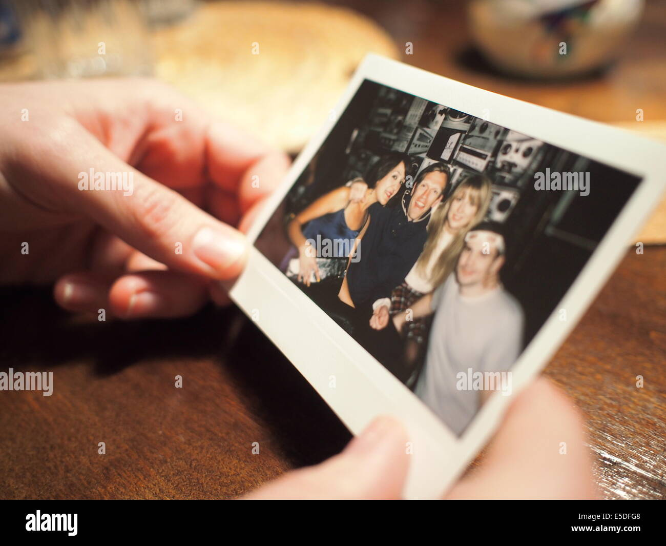 Reminiscing, looking back on special Polaroid moments - Stock Image