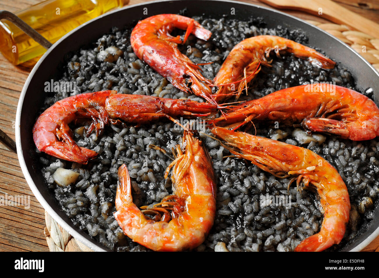 closeup of spanish arroz negro, a typical rice casserole made with squid ink Stock Photo