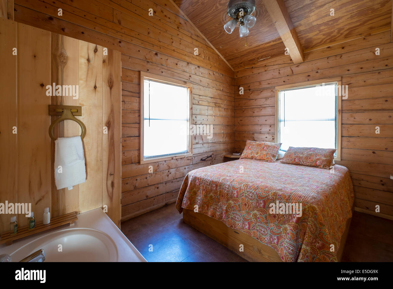 Usa Texas Bedroom With Bathroom Vanity In Log Home Stock Photo Alamy