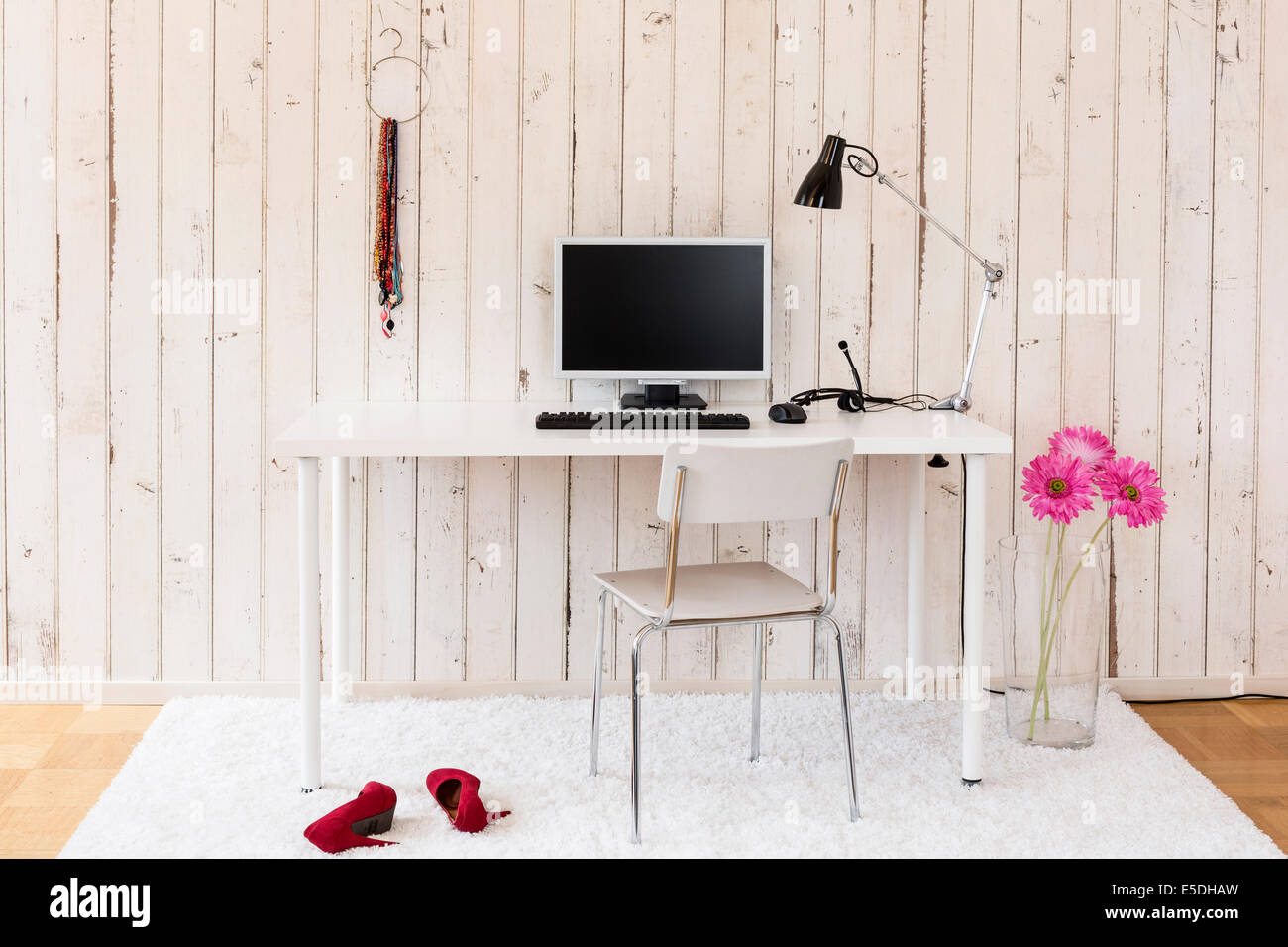 Simple home office with personal computer and personal stuff - Stock Image