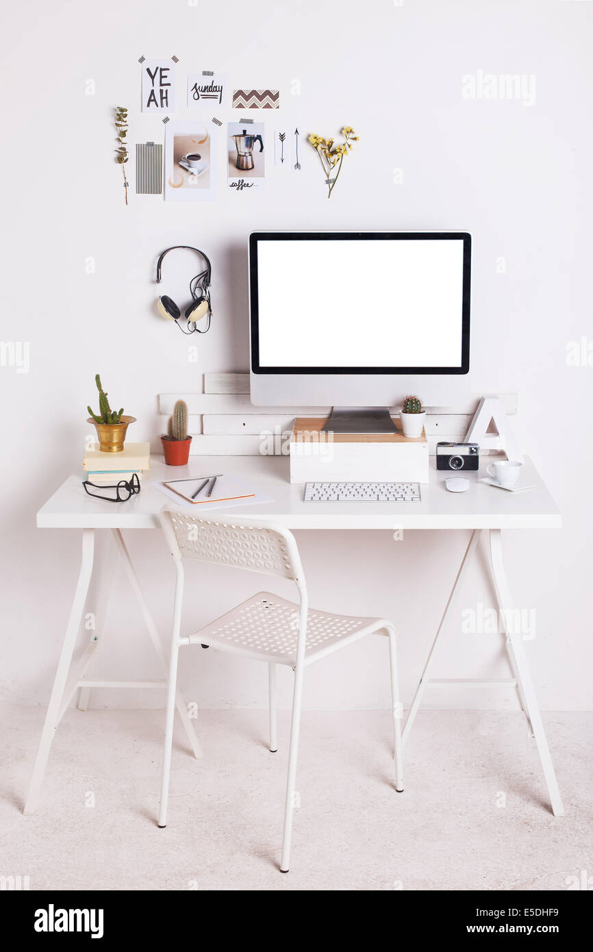 White workroom with computer monitor - Stock Image