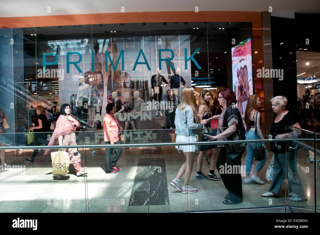 London July 2014. Westfield shopping centre, Stratford. Shoppers in front of Primark clothes shop. Stock Photo