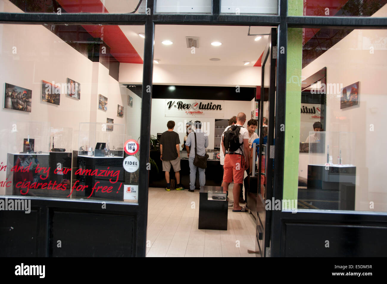 London July 2014. Covent Garden. E cigarette shop called V-revolution - Stock Image