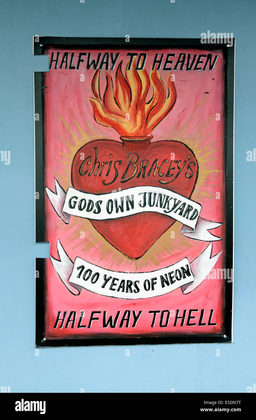 Gods own junkyard poster or sign 100 years of neon outside neon lighting shop in Walthamstow, London Borough of - Stock Image