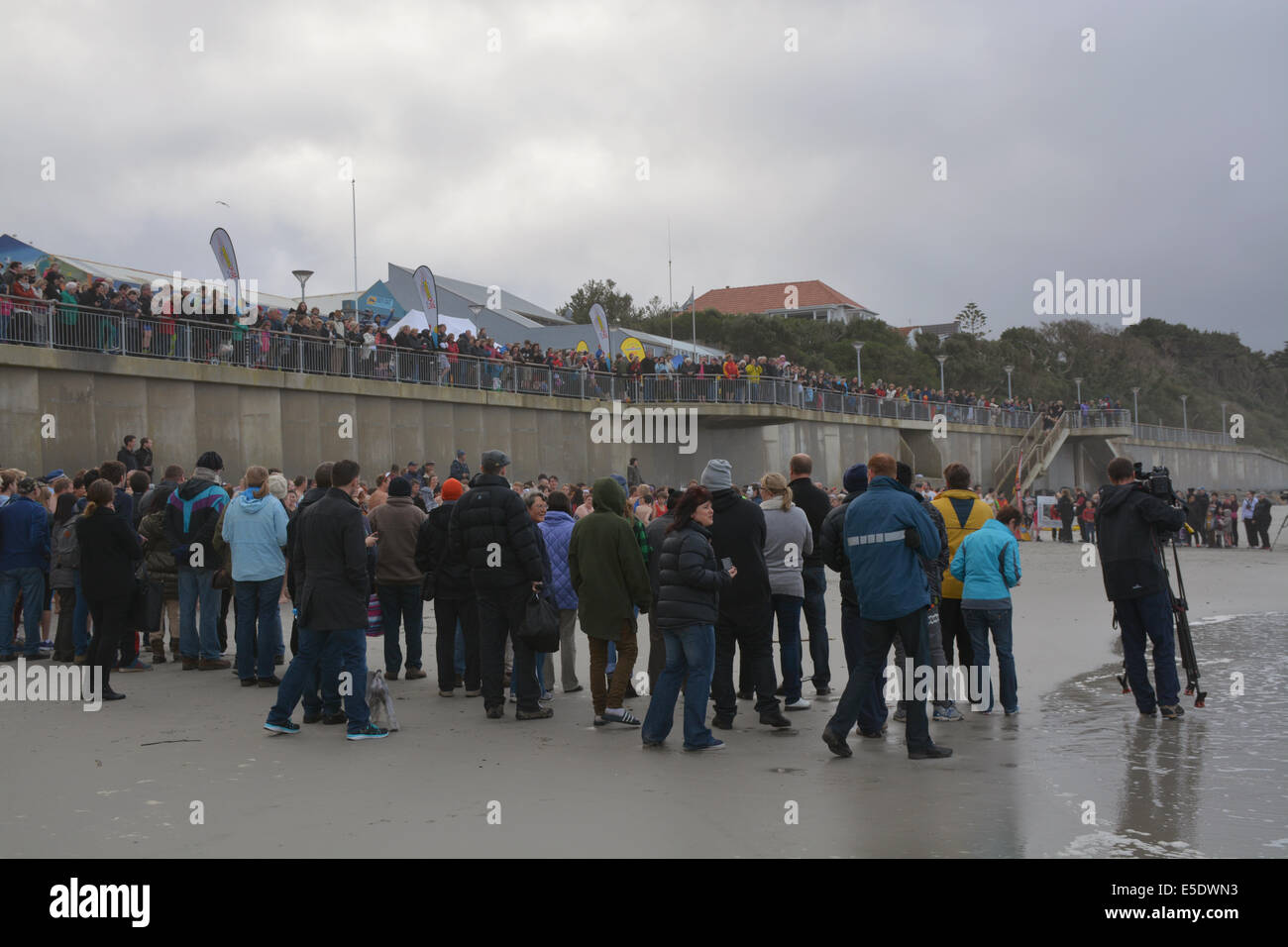 Swimmers getting ready for the Dunedin's annual midwinter Polar Plunge held at St Clair Esplanade - Stock Image