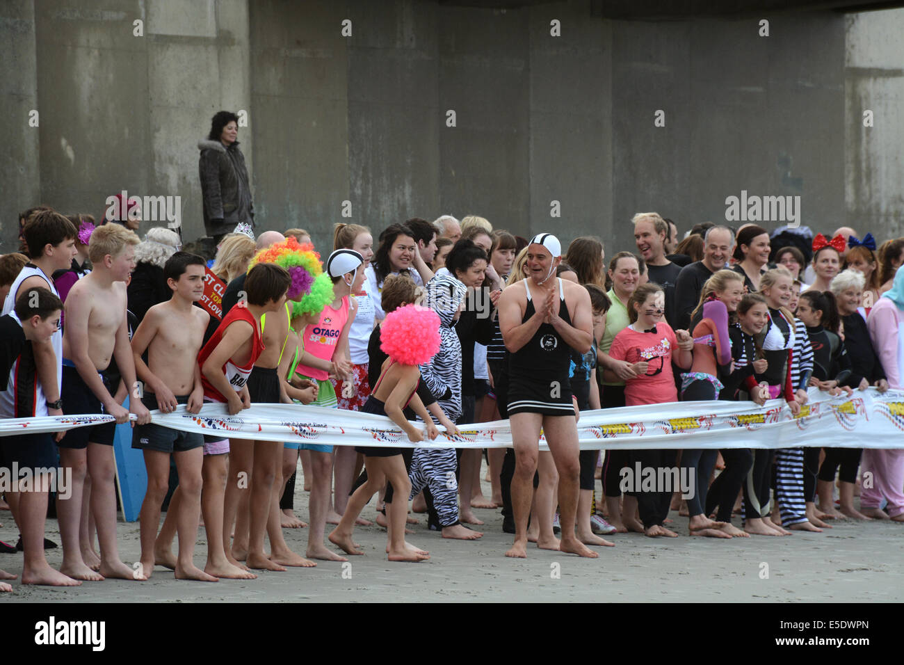 Swimmers getting ready for the Dunedin's annual midwinter Polar Plunge held at St Clair Esplanade. - Stock Image