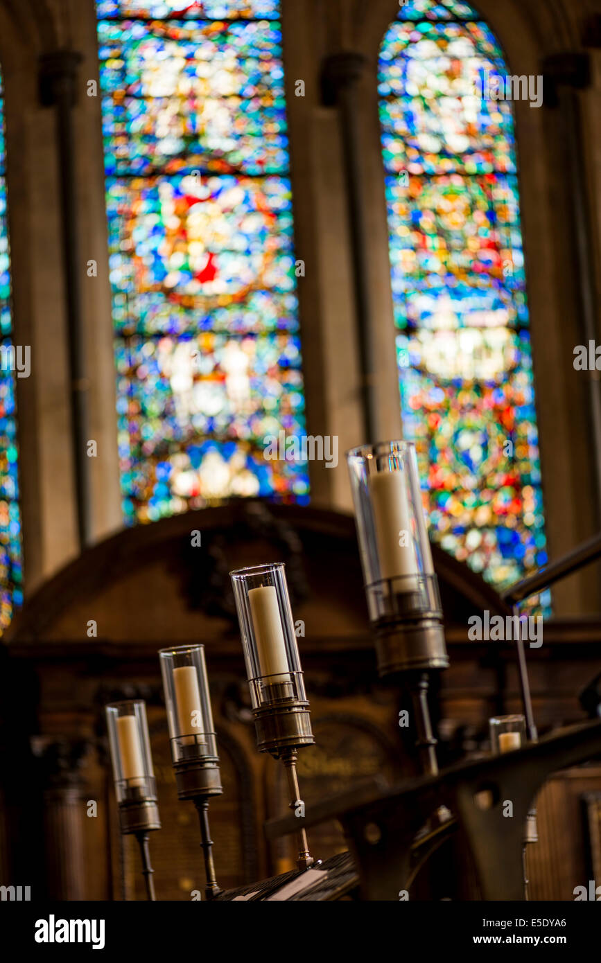Candles and stained glass windows at Temple Church. The Temple Church is a late 12th Century church in London - Stock Image
