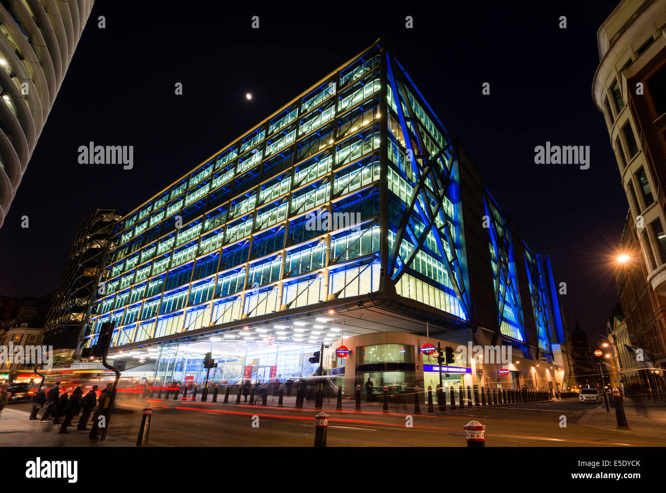Cannon Street Station, railway terminus, London Underground and offices, at night, lit in electric blue in the City - Stock Image