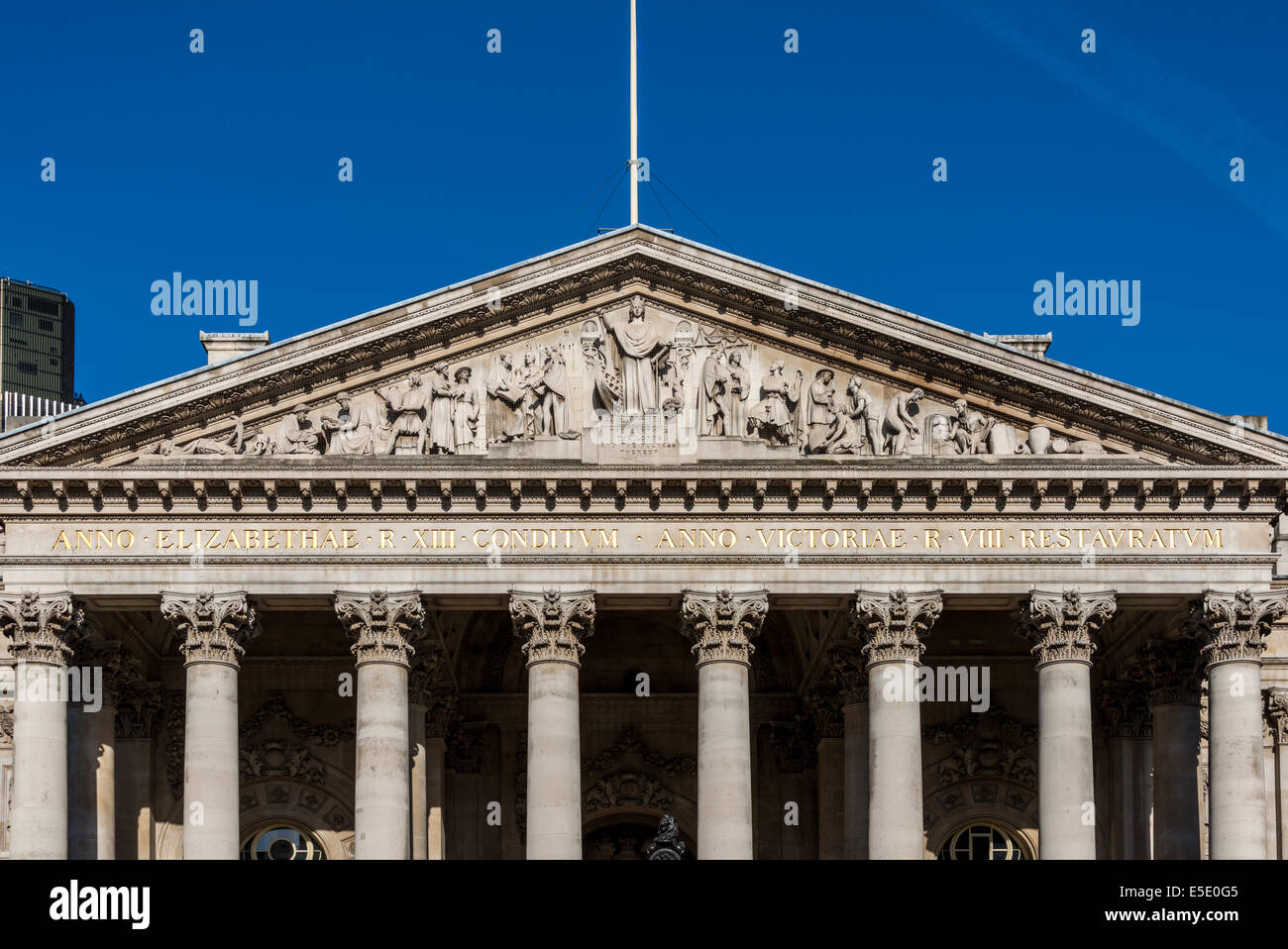 The pediment of the Royal Exchange in the City of London. The front is a portico of eight Corinthian columns - Stock Image