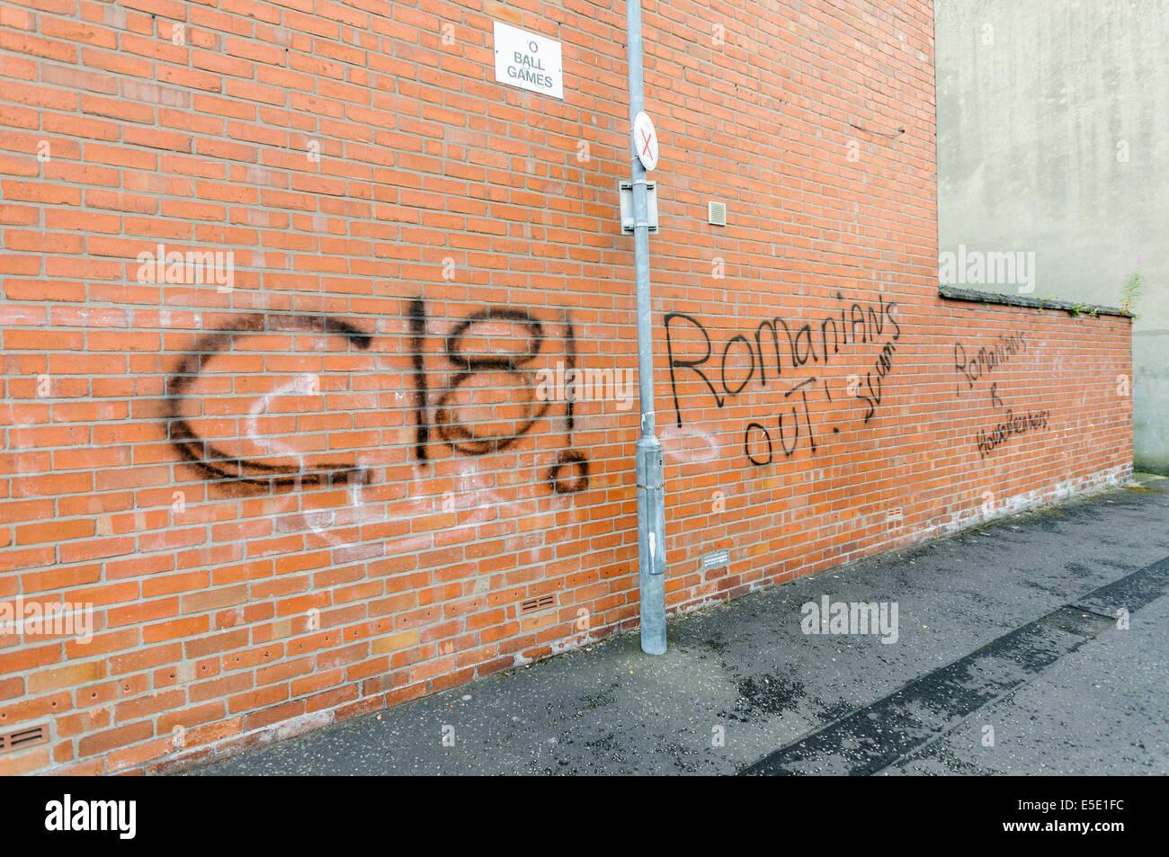 Belfast, Northern Ireland. 29th July, 2014. Graffiti saying 'C18! Romanians Out! Scum.  Romanians R [sic] Housebreakers' - Stock Image