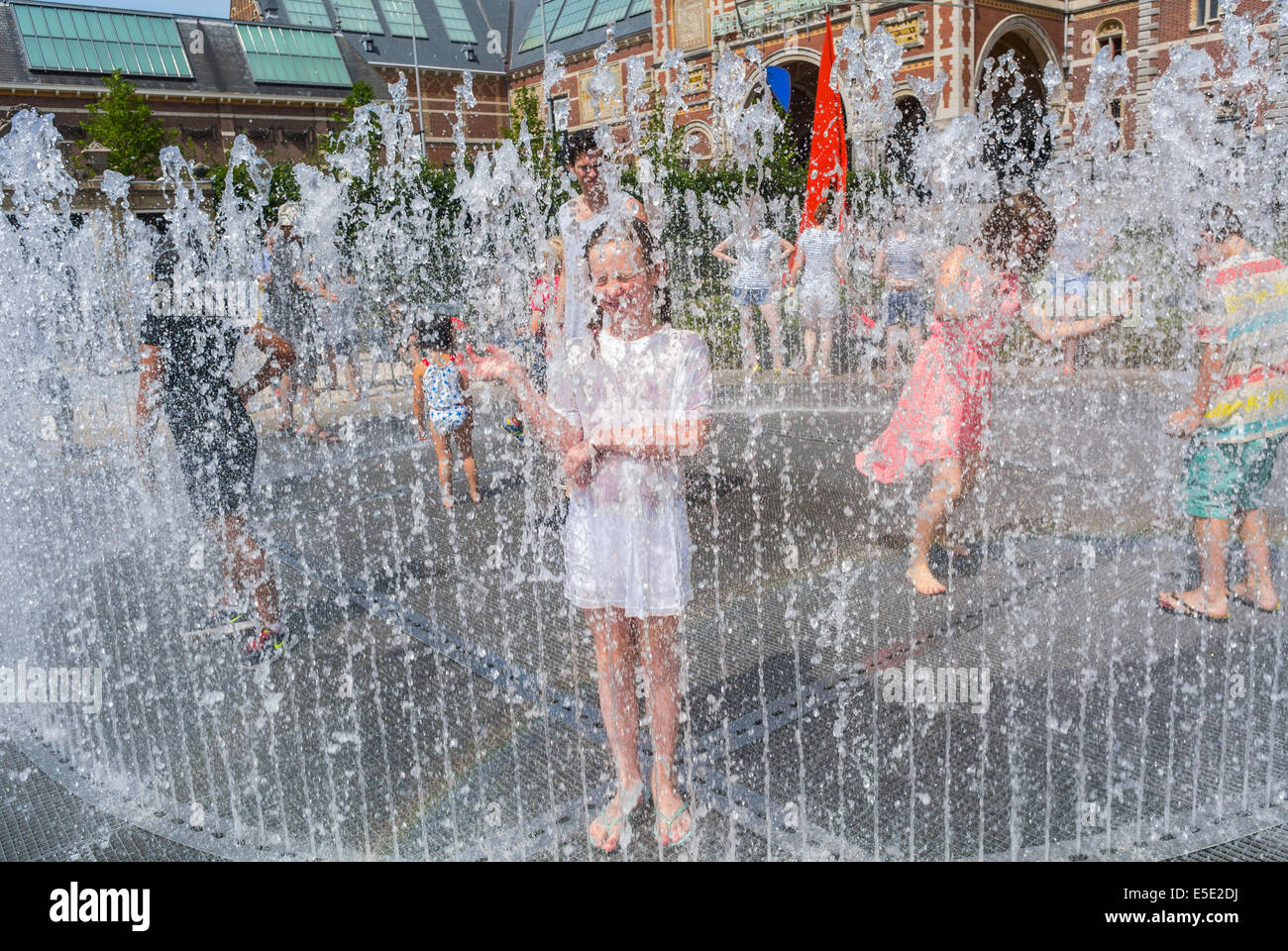Amsterdam, Holland, The Netherlands, Tourist Children Cooling off in Public Garden Fountains during Summer Heat - Stock Image