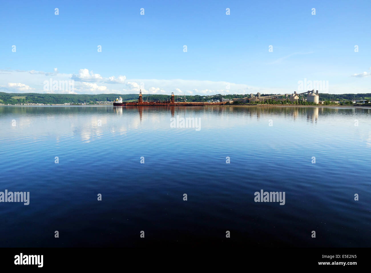 Industrial port in deep water fjord bay - Stock Image