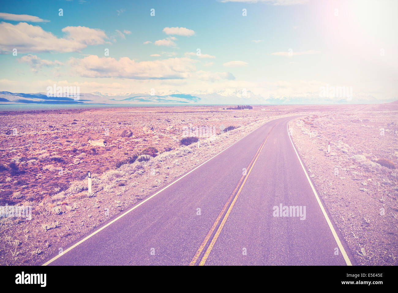 asphalt country road with back light, vintage style - Stock Image