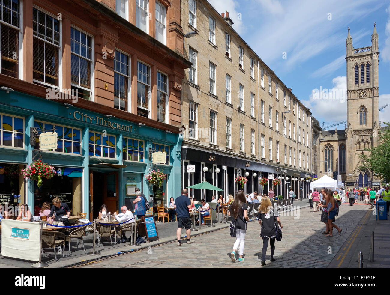 outdoor eating and drinking in Candleriggs during the International market  in the Merchant City Glasgow Scotland - Stock Image