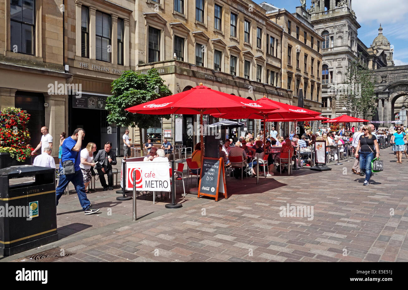 Outside eating & drinking during the International market in John Street in the Merchant City Glasgow Scotland - Stock Image