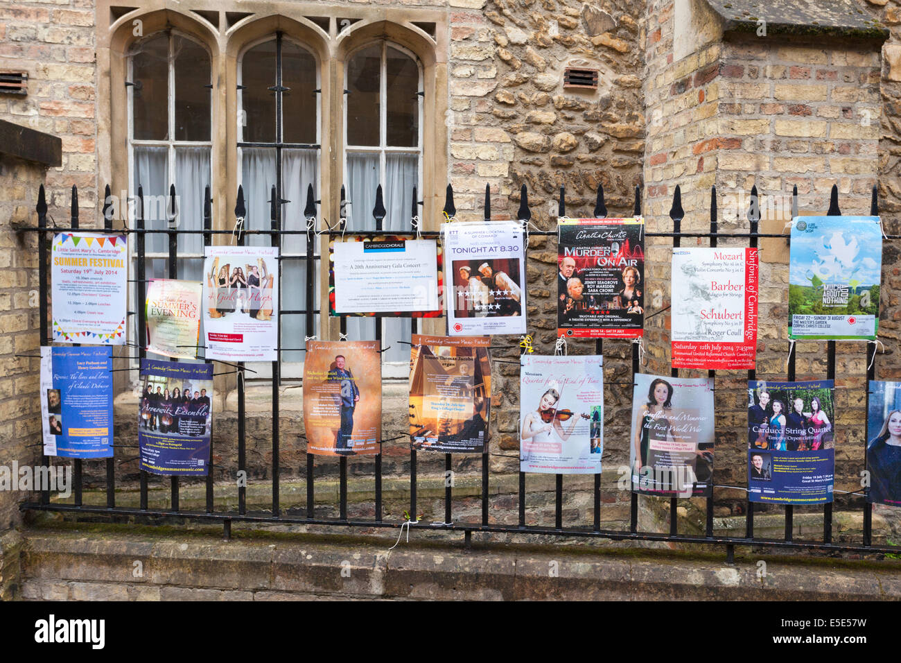 Advertisements for concerts on a wet day in the university city of Cambridge UK - Stock Image
