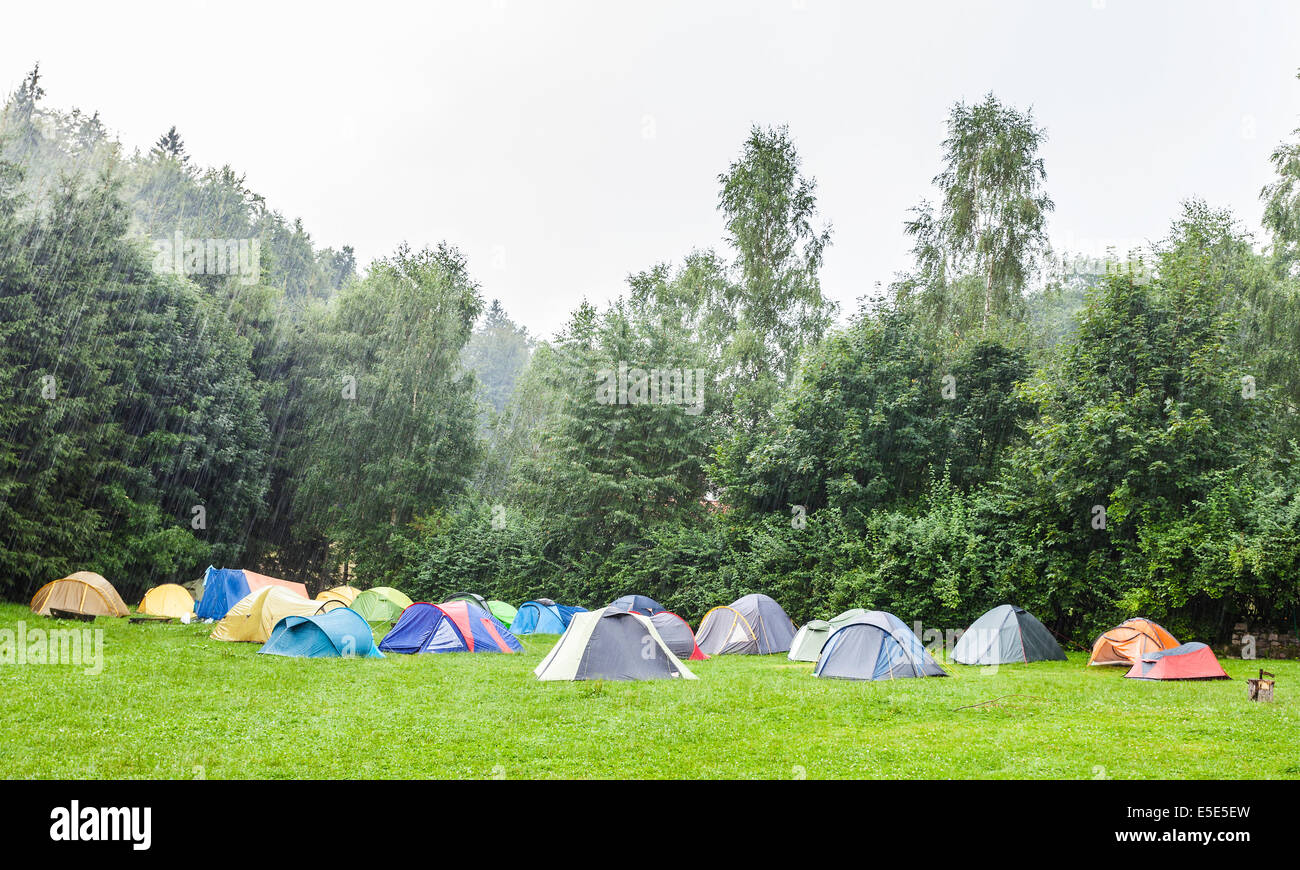 Tents in camping site in the rain. - Stock Image