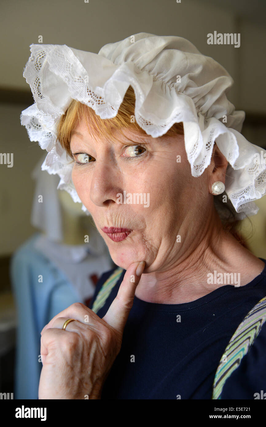 Saucy maid woman wearing victorian servants hat - Stock Image