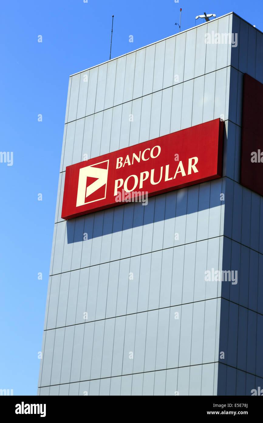 Banco Popular building and huge sign against a blue sky Lisbon Portugal - Stock Image