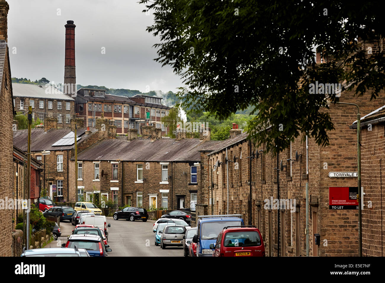 New Mills Derbyshire UK view of the towns famous sweet factory home to Swizzles Matlow towering over the  two up - Stock Image