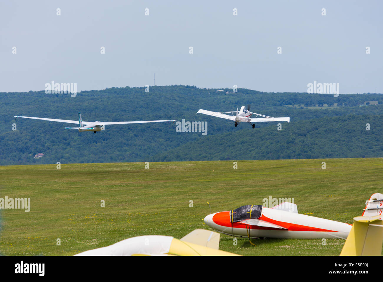 Glider being towed up at Harris Hill Soaring Center in Horseheads near Elmira New York - Stock Image