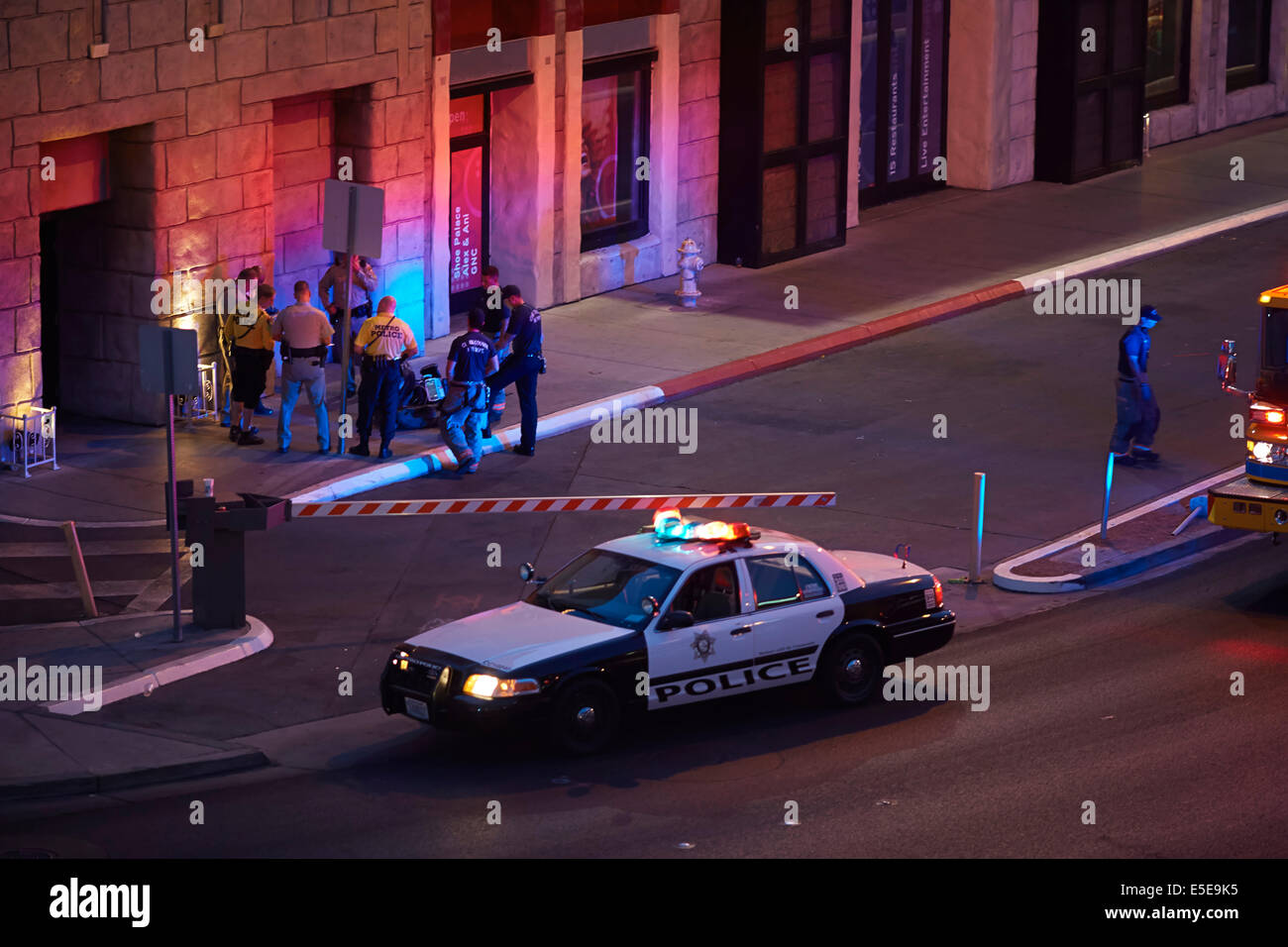 Police department officers attend a scene just off the Strip at Las Vegas Boulevard South, in Paradise, Nevada USA - Stock Image