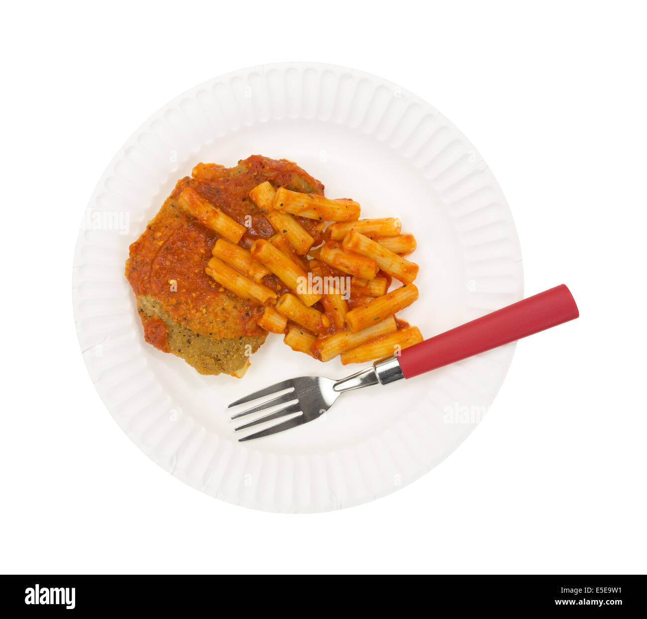 A TV dinner of breaded chicken with pasta in tomato sauce on a paper plate with a fork on a white background. - Stock Image