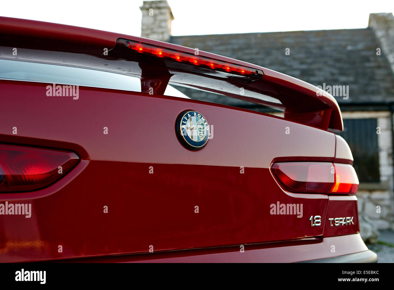 rear spoiler and high level brake light on rear of Alfa Romeo 156 - Stock Image