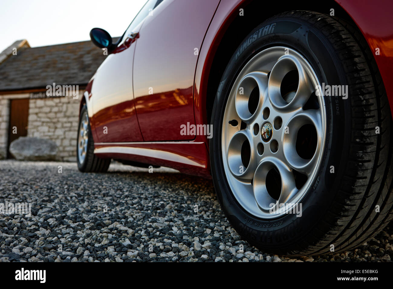 alloy wheels and new tyres on an Alfa Romeo 156 - Stock Image