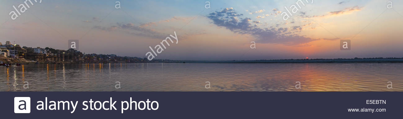 Panorama of the Ganges River in Varanasi, India taken from the river right at sunrise. - Stock Image