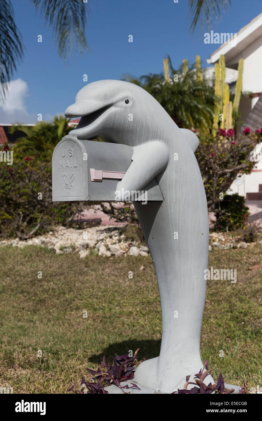 Kitschy 5' Tall Fiberglass Bright Gray Dolphin Mailbox, Residential Home, Florida, USA - Stock Image
