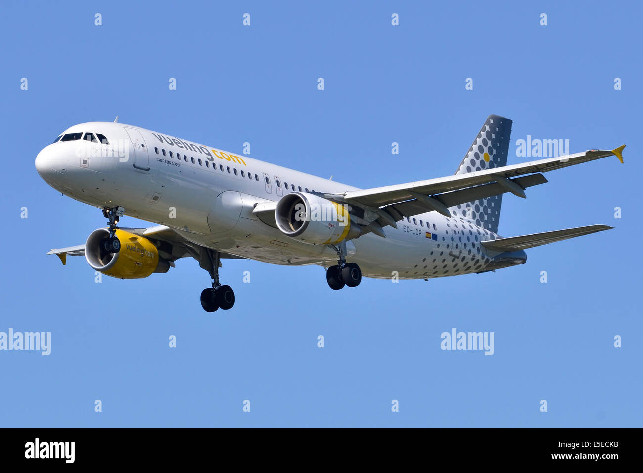 Airbus A320 operated by Vueling Airlines on approach for landing at London Heathrow Airport - Stock Image