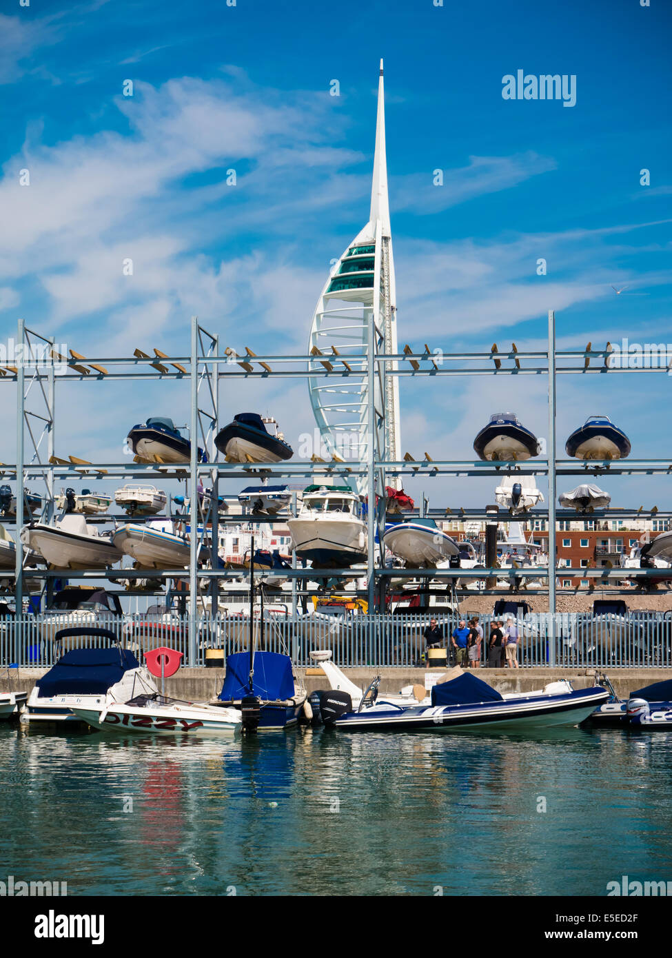 Multi storey boat rack holding Rigid inflatable boats at Camber Docks in Old Portsmouth. Stock Photo
