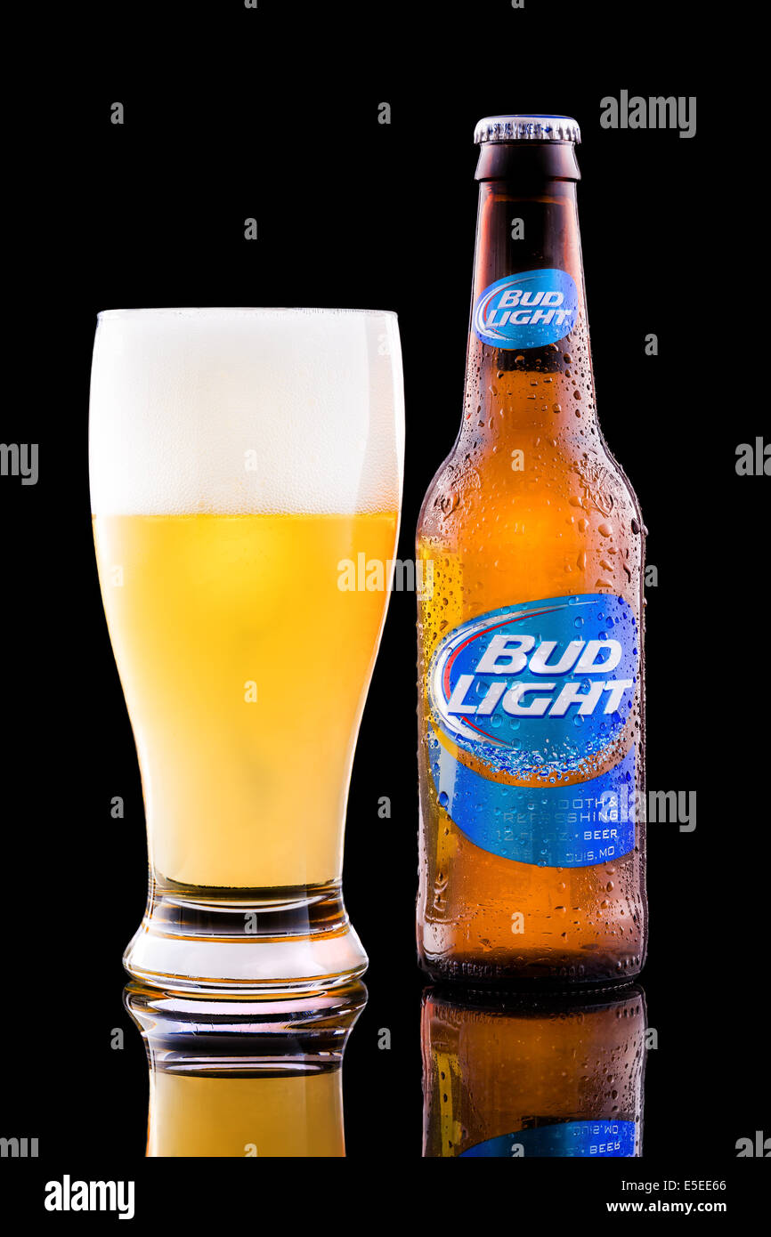 Bottle and glass full with Bud Light beer. - Stock Image