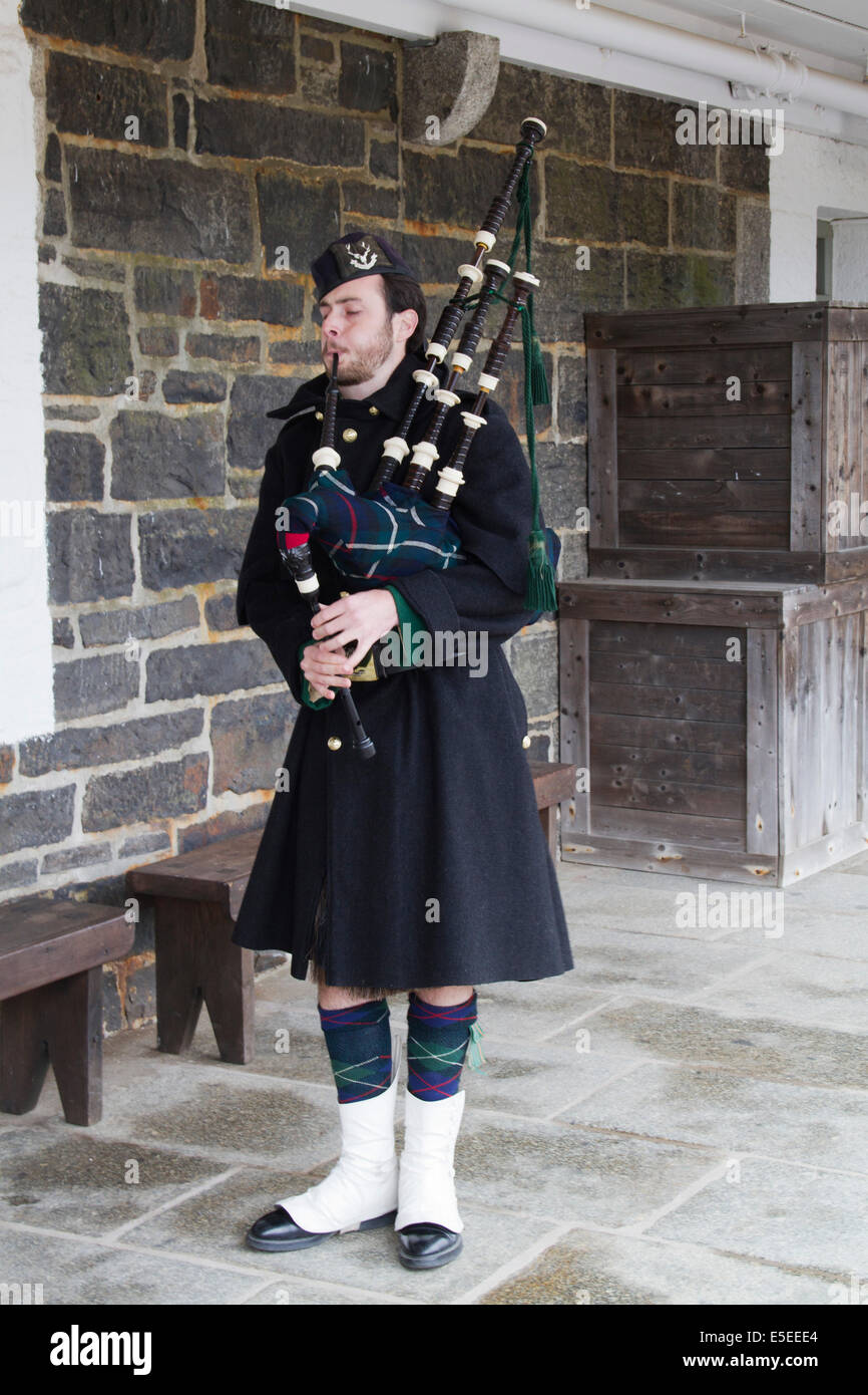 Piper in the uniform of the 78th Highlands performs at the Halifax Citadel.Halifax,Nova Scotia,Canada - Stock Image