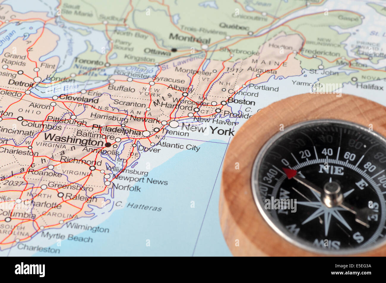 Compass on a map pointing at United States and planning a travel ...