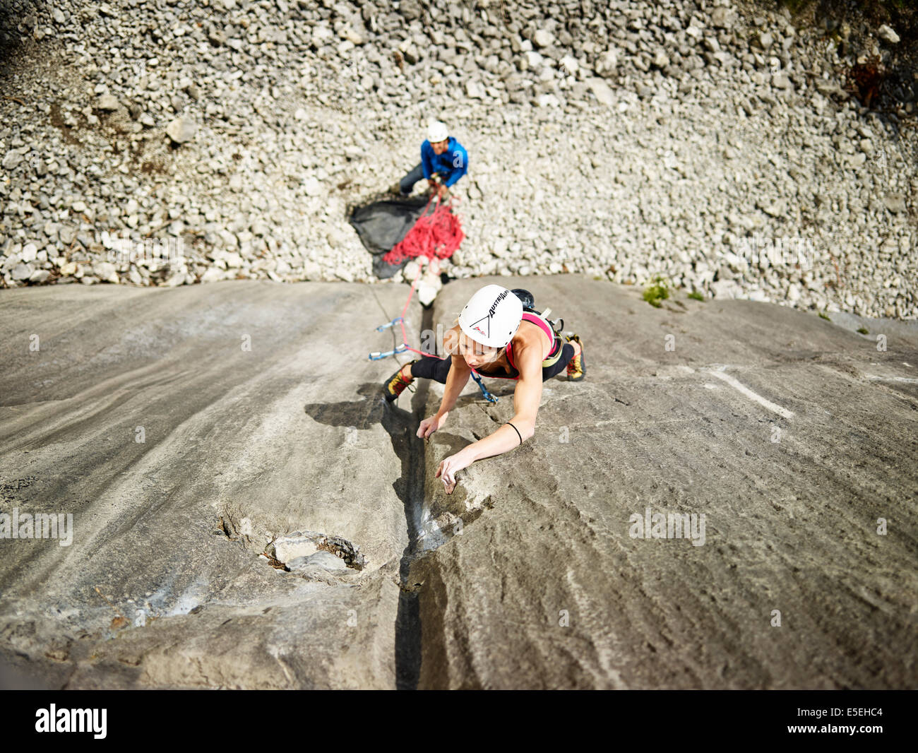 Woman lead climbing a gully, crack in the rock, Martinswand climbing area, Zirl, Tyrol, Austria - Stock Image