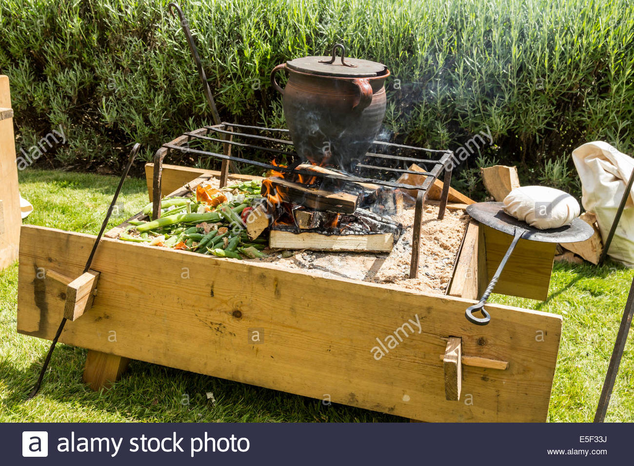Cooking pot on an open camp fire - Stock Image