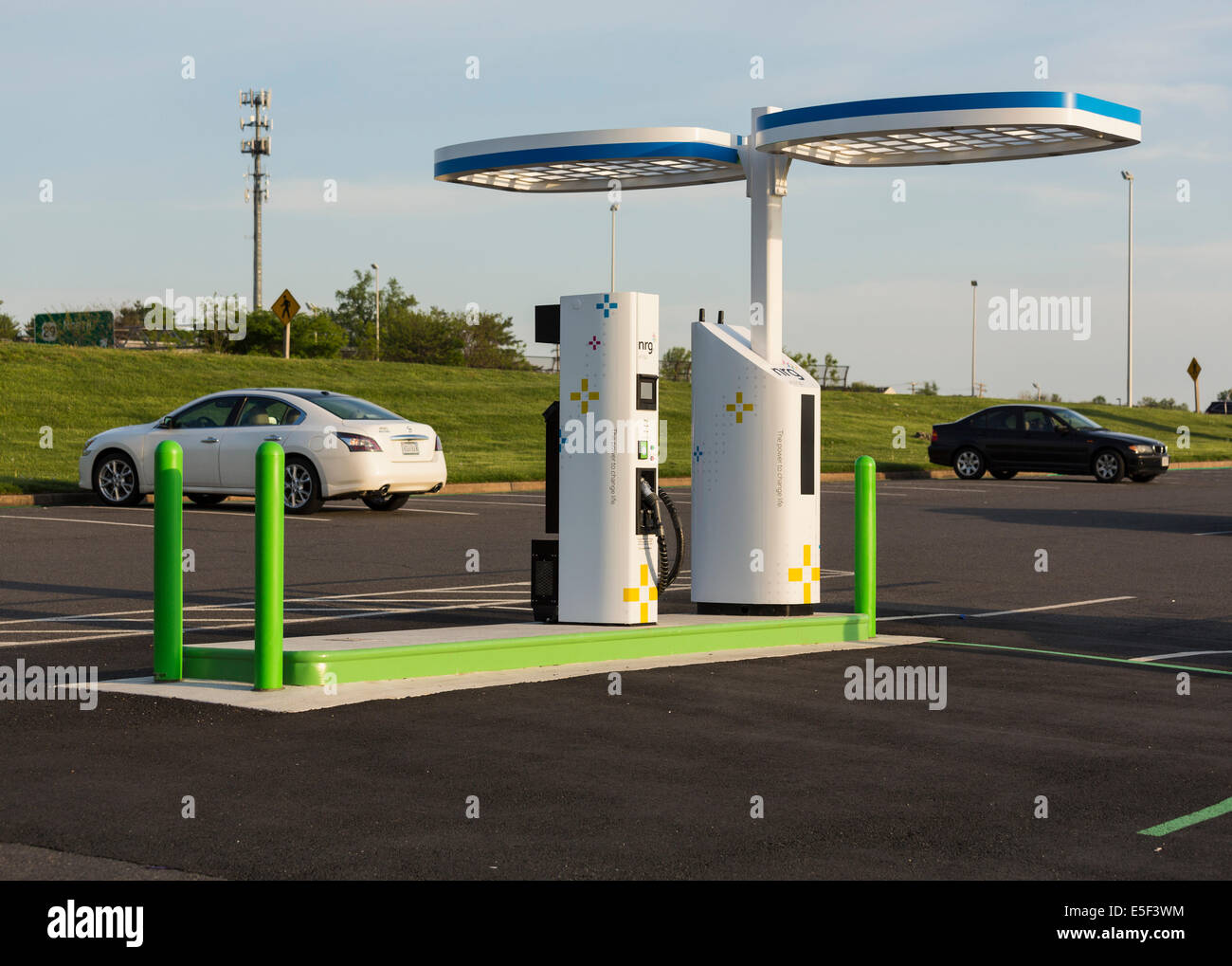 Electric car charging station and parking lot in USA installed by NRG eVGO to recharge electric cars - Stock Image