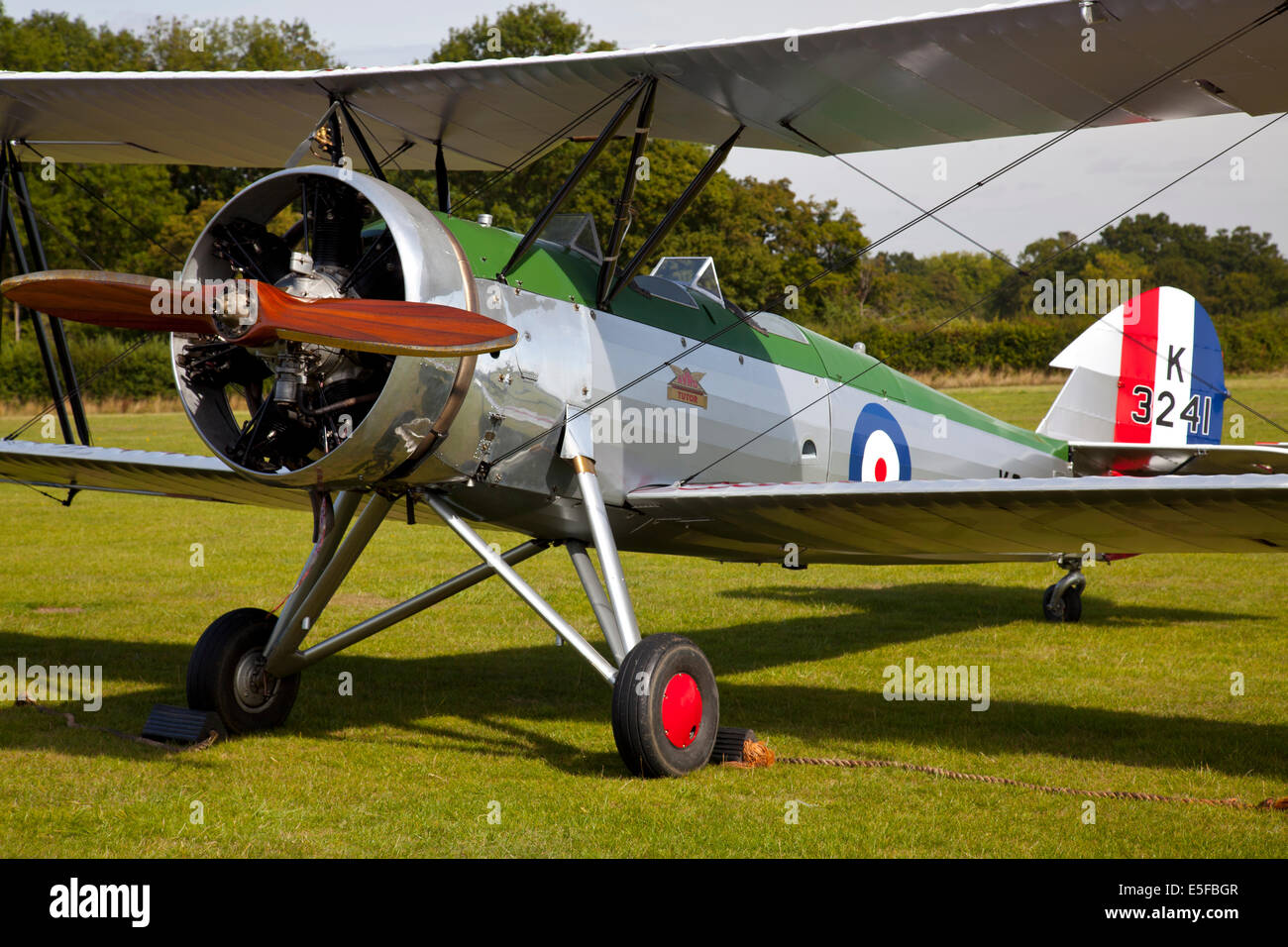 England UK circa 2014 The Avro Tutor K3241 Bi Plane moored at a vintage air pageant before display - Stock Image