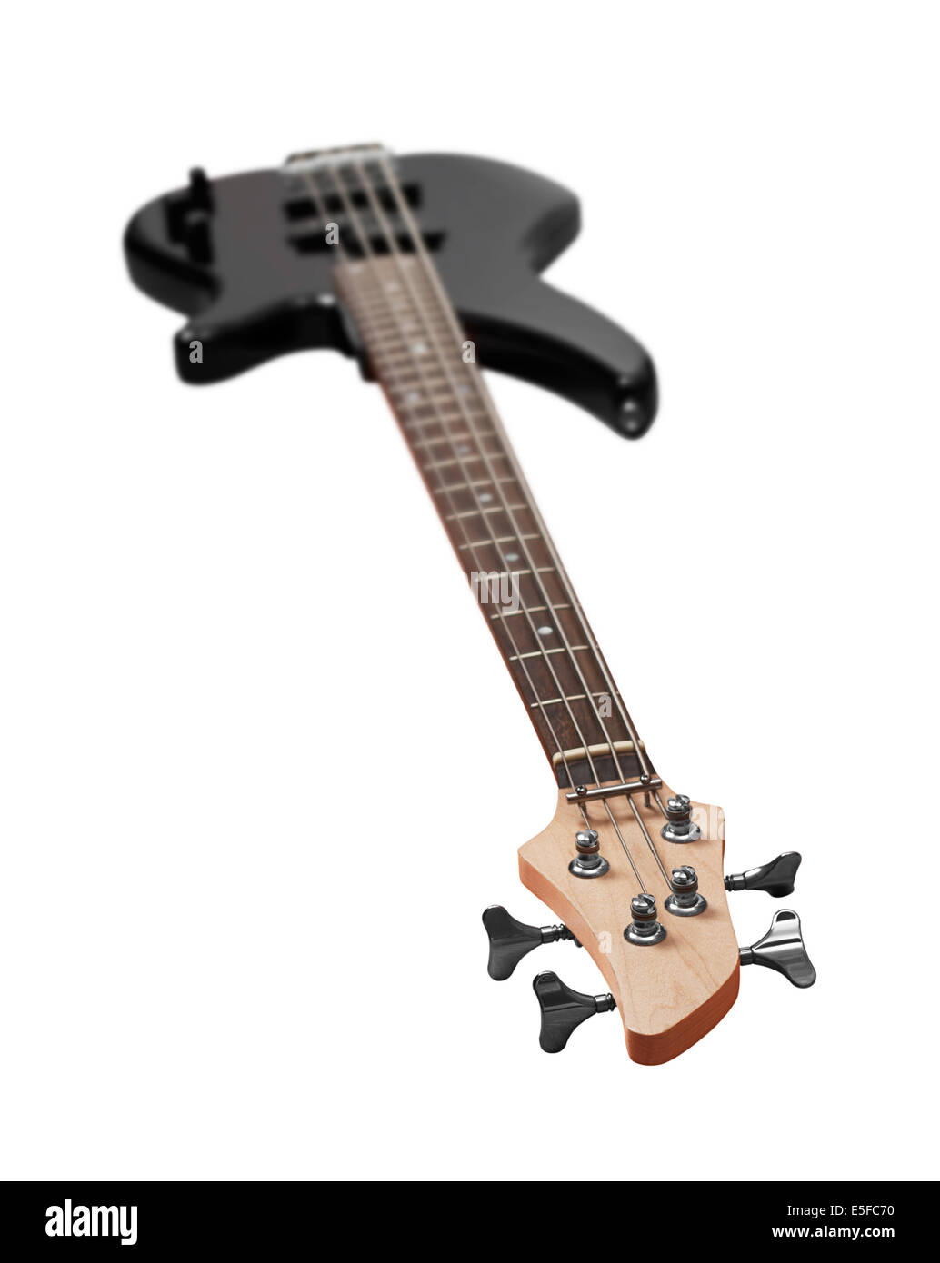 Black bass guitar on awhite background - Stock Image