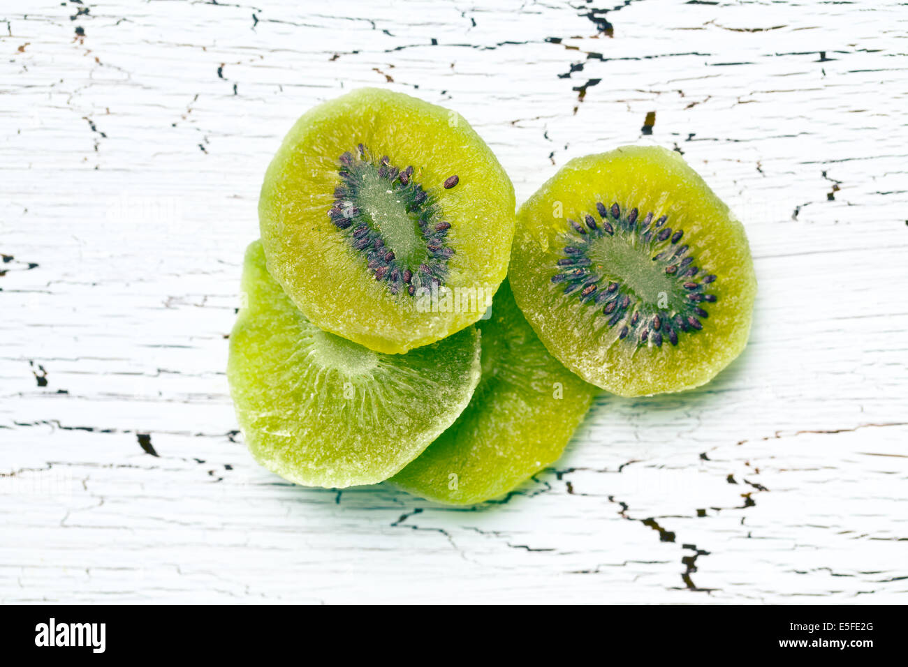candied kiwi fruit on wooden table - Stock Image