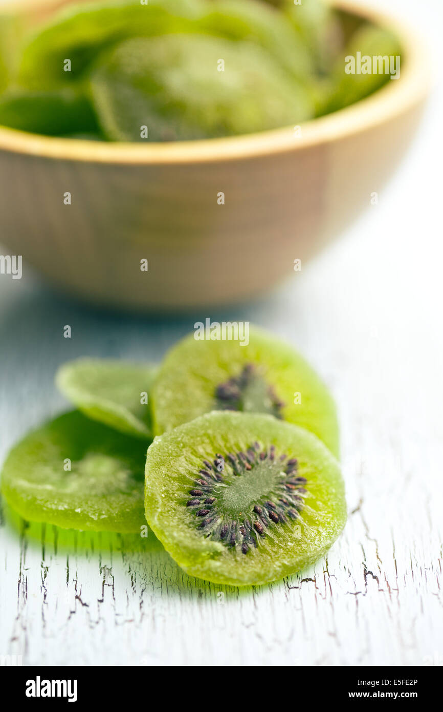 candied kiwi fruit on wooden table Stock Photo