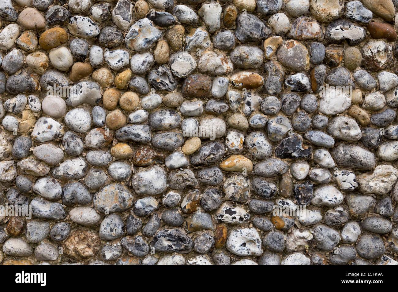 Detail of flint stone walling in Suffolk, England - Stock Image