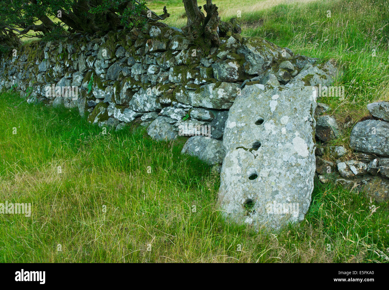 Old-fashioned gatepost, Lake District, Cumbria, England UK - Stock Image