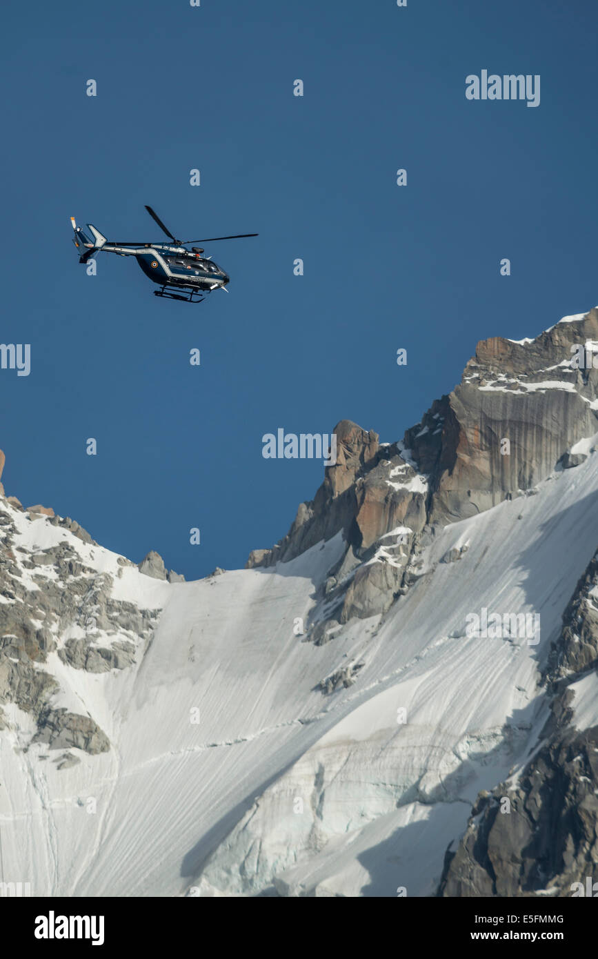 Helicopter of the Gendarmerie in flight, in front of the Mont Blanc massif, Chamonix-Mont-Blanc, Haute Savoie, Rhône - Stock Image