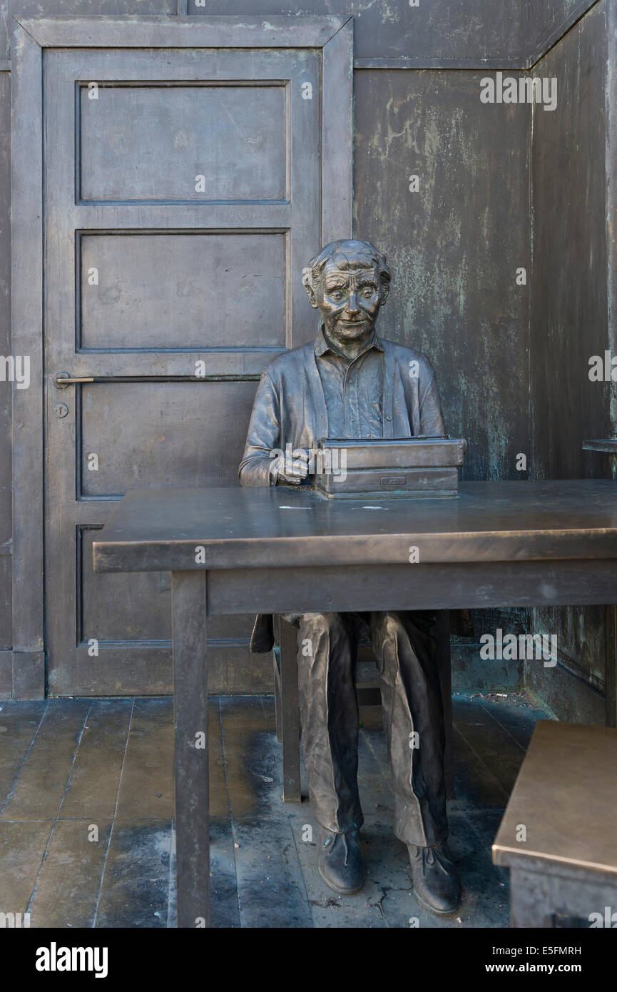 The children's book author Astrid Lindgren in her office at her typewriter, bronze statue by Marie-Louise Ekman - Stock Image